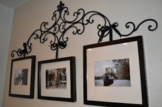 Wrought iron picture hanger with revamped frames.       My theme is black and white. But this would look so pretty in other colors too. ...