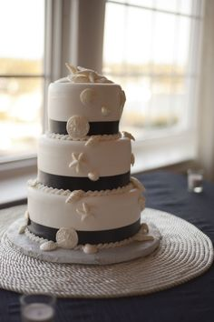 If I was going to have another wedding reception, this would be my cake!! my stripes would be navy blue ;)    Chantilly Cakes of St. Pete Beach