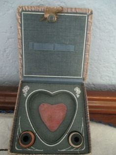 Vintage sewing box kit with heart pincushion and thread. With turtle on top