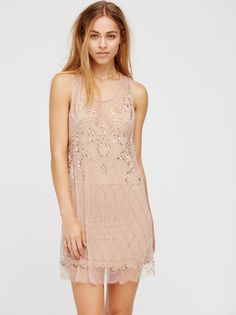 Verona Slip   Sheer mesh scalloped hem slip featuring allover embellishment detailing featuring bead and sequins. Racerback and dropped armholes.