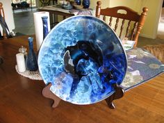 "13"" altered platter on stand.  Multiple glazes but mainly blue."