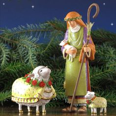 "Patience Brewster Manger Shepherd, Ewe, and Lamb - 10"" scale (8.5""H) Manger Shepherd with Ewe and lamb from the Patience Brewster Nativity Collection is beautifully hand-crafted.   Patience Brewster put amazing detail into the design of this Shepherd, Ewe, and lamb.  Each figure carries the PB11 stamp of authenticity. Item #82006 Our Price: $89.00"