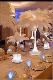 I personally did this for my wedding. ostrich feather centerpieces with lighting at the base of the eiffel tower vase. And, PETA friends, many of the ostrich feathers used now come from harm free farms! Feather on! Sweet 16 Masquerade, Masquerade Theme, Masquerade Wedding, Masquerade Ball, Gatsby Wedding, Wedding Centerpieces, Wedding Favors, Party Favors, Wedding Decorations