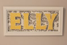 Framed fabric with fabric-covered letters glued on top. Could do with craft paper modge podged onto letters too. Fabric Covered Letters, Framed Fabric, Fabric Letters, Fun Crafts, Diy And Crafts, Wood Crafts, Name Frame, Wood Letters, Framed Letters