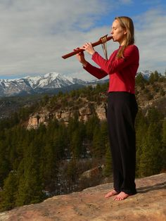 NAF player enjoying her flute in the western US mountains.