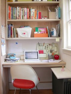 If you don't have much space in your apartment, go vertical with shelves above your desk to create an office nook.