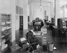 "Library science study hall, 1928. Student Edith Wilson  in foreground. Folder ""Early Library Scenes"" Box 35, UM  School of Information records"