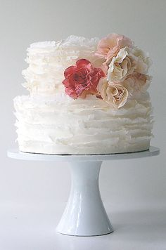Cluster Of Roses Complements The Ruffles On This White Wedding Cake cakepins.com