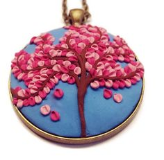 Tree of life cherry blossom necklace made with polymer clay with applique technique, turquoise background with red and pink blossoms, intricate detailing, all handmade. Only $30.00! Clay charm Polymer clay necklace Polymer applique by Charms4Now