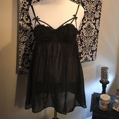Lane Bryant 14/16 black caged lingerie 2-piece set Lane Bryant 14/16 black caged lingerie 2-piece set. 3 hooks in back, adjustable straps. Comes with black see through thong attached on the back. 14/16 thong. Lane Bryant Intimates & Sleepwear