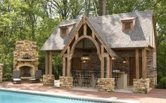 massive pool house with outdoor kitchen and fireplace remodeled by CASEIndy