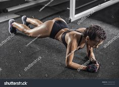 https://image.shutterstock.com/z/stock-photo-young-woman-doing-plank-exercise-at-gym-1045321210.jpg