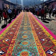 Street carpet in Antigua, Guatemala for Holy Week. Composed of colored sawdust, flowers, fruits and vegetables.~via Irish Soldiers ♥