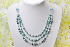 The final look of the triple strand pearl necklace
