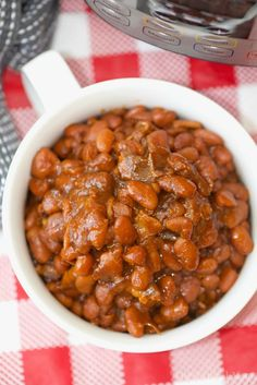 These are some of the most amazing no soak Instant Pot baked beans you'll ever eat! Perfectly cooked in your pressure cooker with no pre soaking required. They're a great sweet and savory side dish for any barbecue and you can add a bit of heat to them too if you want.