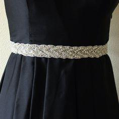 Wedding sash, beaded rhinestone crystal Bridal Sash Belt with satin ribbon, bridal accessories. $78.00, via Etsy.