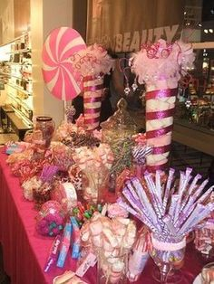 Pink and White marshmallows in tall vases white pink sparkly ribbon make awesome decorations!