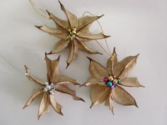 """""""Southern Poinsettia"""" Ornament made from the burr of the cotton boll!"""