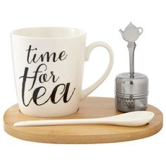"The perfect cup is just a pour away with our new tea-lover's set. It comes with a generously sized cup, single-serve stainless steel infuser and ceramic stir spoon. Everything securely rests on a specially designed wood tray, making it perfect for work or school. The set comes beautifully boxed and makes an easy gift for any tea lover. Cup: 10 oz. capacity. 3.4"" diameter, 3.6"" tall. Ceramic mug and bamboo tray. Mug is Dishwasher and microwave-safe. Available only at Indigo."