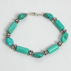 "Handmade gemstone turquoise bracelet features semi-precious turquoise gemstone tubes and nuggets, sterling silver beads, and lobster claw clasp. 8 1/2"" in length. Add a necklace, pendant and earrings"