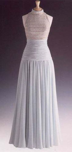 Designed by Catherine Walker, this pale blue and gray chiffon gown has a high cut bodice embroidered with simulated pearls and glass beads. Diana wore this gown on May 6, 1992 to a reception at Spencer House as patron of the London City Ballet. Lot #70 raised $ 36,800.00 for Diana's charities.