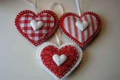 * Set of 3 Heart Ornaments  * Handmade using wool blend felt and fabric  * Lightly filled with Poly-Fil  * Size 3.5 W x 3 H