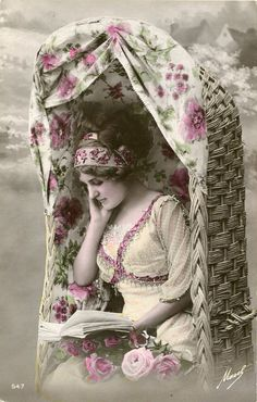 Original French vintage hand tinted real photo postcard - Lady reading in beach chair