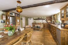 The open plan kitchen and breakfast room in the (English) Grade-II listed building has polished wood...
