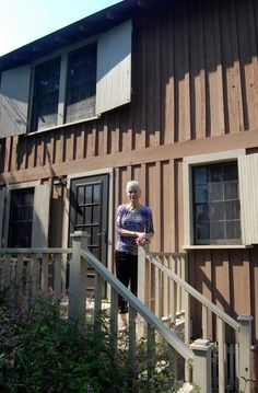 "Kathy Glick stands on the porch of the historic Porgy House. Ties to the book, ""Folly Beach."""