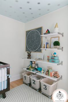 inexpensive custom floating shelving design using IKEA shelves. Upper shelves for mementos, lower shelves for toy storage. Love the numbered bins.