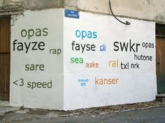 Mathieu Tremblin paints over graffiti tags, and re-stencils them. But not in graffiti script—in Helvetica, Arial, Times New Roman, and Georgia.