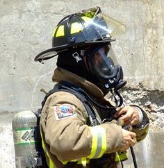 The firefighter shown is wearing an SCBA (Self contained breathing apparatus). This is an essential part of a firefighters gear. It allows him to enter hazardous environments and still breathe safe air.
