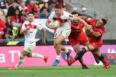 Canberra Raiders Elliott Whitehead of England (L) makes a break during the 2017 Rugby League World Cup Semi Final match between Tonga and England at Mt Smart Stadium on November 25, 2017 in Auckland, New Zealand.