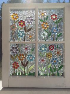 Or lay flower designs among the plastic beads and melt together for window panes