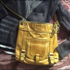 The Sak crossbody It was once green but is now a fabulous chartreuse. It's the perfect city bag to pair with jeans and a tee. Good condition! The Sak Bags Crossbody Bags