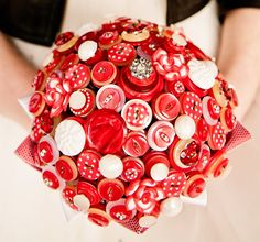 Fabulously retro bouquet in a polka dot theme! Shown here in red and white but available in most colour schemes... just ask! Matching buttonholes