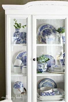 blue and white transferware china dishes in white hutch cabinet...<3...