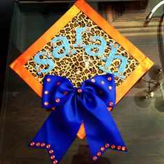 Grad cap with a bow. So cute for shsu but no leopard for me.