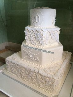 Vintage lace and flower wedding cake.