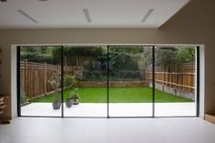 A contemporary renovation, using minimally framed sliding glass doors as well as various elements of our modern architectural glazing such as structural glass floors and frameless glass balustrades...