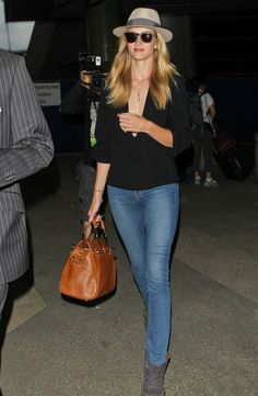 Rosie Huntington-Whiteley gives us Airport style envy wearing J BRAND 811 Skinny Leg in Bayside.