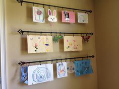 Kids Art Wall - used curtain rods with clip rings so can adjust size to art & easily change as my lil artists create new art. Easy to install only few screws on each side. B/C my fridge was completely covered ;)