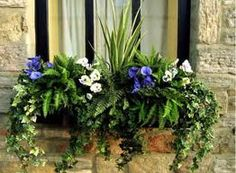 fake flowers in window boxes
