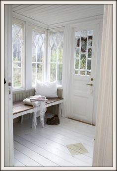 Love! Windows, boards on ceiling and floor, bench with pillow