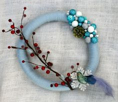 Awesome Christmas or Holiday wreath! Put a bird on it! http://www.etsy.com/listing/85531414/blue-and-red-bird-and-ornament-wreath