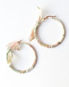 SALE - reduced from $36 for a limited time only. These fashion forward earring make a big statement - but are light and sweet to wear.  A stainless steel rose gold plated hoop earring has been wr... Sea Jewelry, Handmade Jewelry, Jewellery, Rose Gold Plates, Fashion Forward, Jade, Fashion Jewelry, Plating, Hoop Earrings