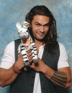 Jason Momoa. He's a lot beefier than the guys I'm usually attracted to, but the hotness cannot be denied.