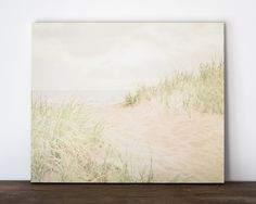 Beach Path Canvas Wrap Artwork, Neutral Coastal Wooden Picture, 8x10 to 30x40 inches, Ready to Hang Gallery Wrap Canvas or Wood Plank Art. This coastal wall art features beautiful a sandy path through the sea grass to the ocean. Artwork is available on your choice of gallery wrap canvas or wooden plank art. Sizes ranges from 8x10 to 30x40. Use the drop-down menu to select the size and type of artwork you would like. Artwork is ready to hang with hardware installed on back. Colors may vary...