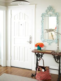 Entry way- vintage sewing table with mirror. LOVE the mirror!
