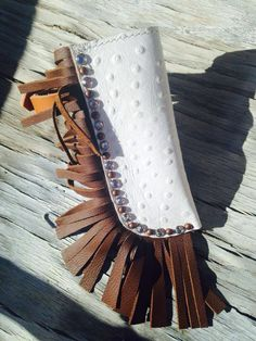 Adorable fringe and blingy white ostrich leather flag boot. Great for carrying flags at rodeos flag team or drill teams! Www.magicscustomtack.com